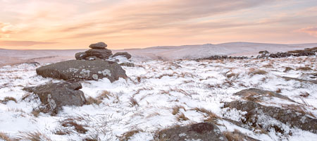 Sunrise from snow covered Belstone Tor, Dartmoor
