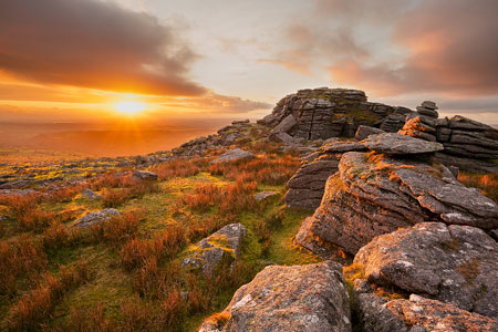 Golden sunlight bathes the land over Kings Tor, Dartmoor