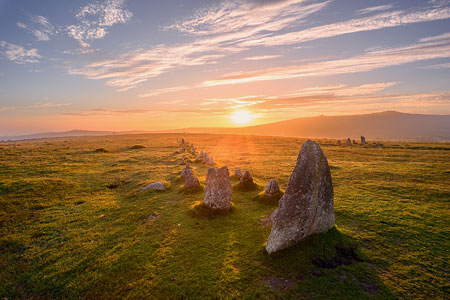 Sunset casting long shadows over the ancient Merrivale stone rows, Dartmoor