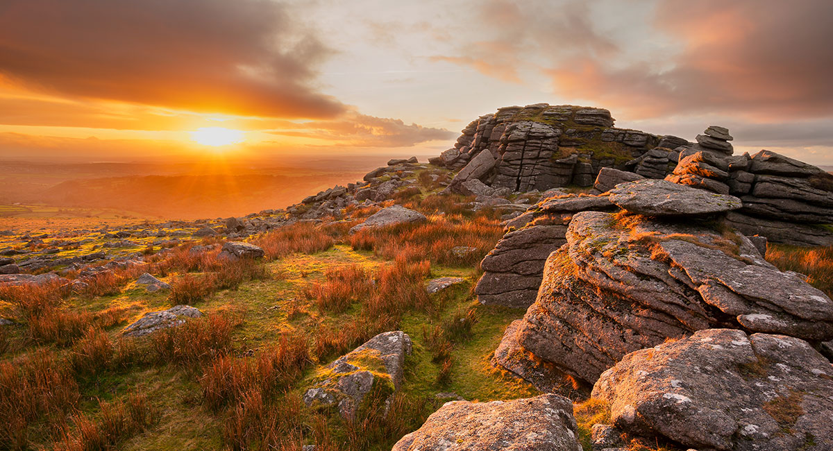 Golden light bathes the moors at sunset from Kings Tor, Dartmoor